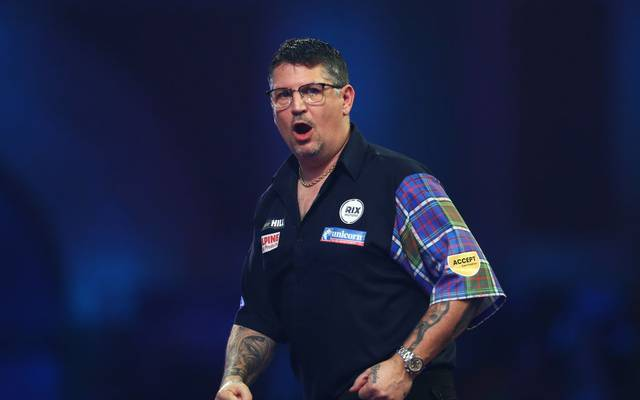 LONDON, ENGLAND - DECEMBER 27: Gary Anderson of Scotland celebrates during his fourth round match against Nathan Aspinall of England on Day 12 of the 2020 William Hill World Darts Championship at Alexandra Palace on December 27, 2019 in London, England. (Photo by Jordan Mansfield/Getty Images)