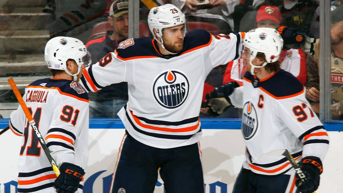 SUNRISE, FL - NOVEMBER 8: Leon Draisaitl #29 celebrates his goal with Drake Caggiula #91 and Connor McDavid #97 of the Edmonton Oilers against the Florida Panthers at the BB&T Center on November 8, 2018 in Sunrise, Florida. The Panthers defeated the Oilers 4-1. (Photo by Joel Auerbach/Getty Images)