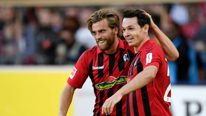 FREIBURG IM BREISGAU, GERMANY - OCTOBER 26: Nicolas Hofler of Sport-Club Freiburg celebrates with teammate Lucas Holer after scoring his team's first goal during the Bundesliga match between Sport-Club Freiburg and RB Leipzig at Schwarzwald-Stadion on October 26, 2019 in Freiburg im Breisgau, Germany. (Photo by Daniel Kopatsch/Bongarts/Getty Images)