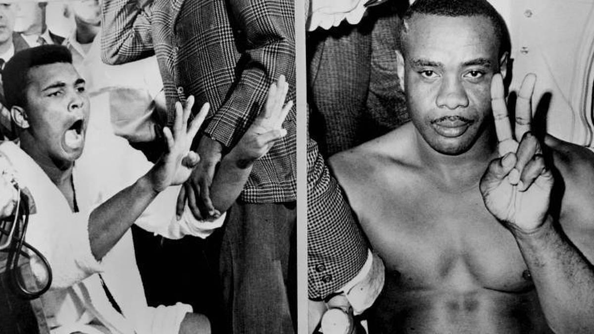 Sonny Liston (r.) und Cassius Clay alias Muhammad Ali beim Wiegen