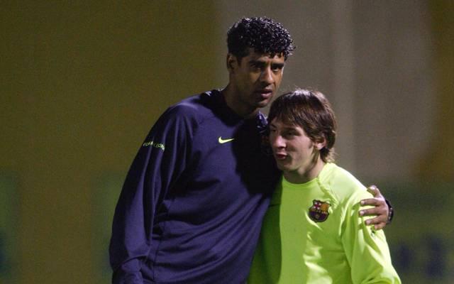 Frank Rijkaard (l.) mit dem jungen Lionel Messi