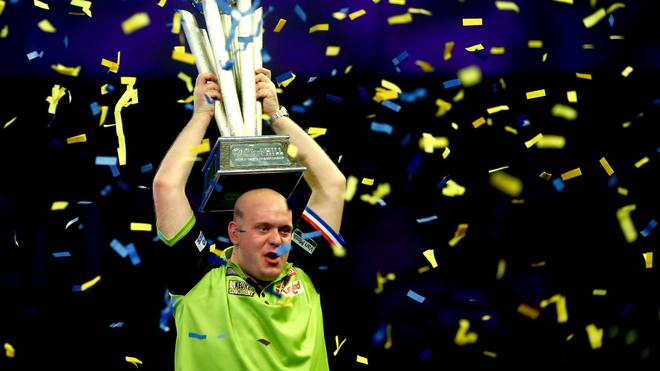 LONDON, ENGLAND - JANUARY 01: Michael van Gerwen of the Netherlands lifts the trophy after victory in the Final match against Michael Smith of England during Day 17 of the 2019 William Hill World Darts Championship at Alexandra Palace on January 01, 2019 in London, United Kingdom. (Photo by Jordan Mansfield/Getty Images)