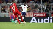 MUNICH, GERMANY - JULY 31: Ryan Johansson of FC Bayern Muenchen (L) and Moussa Sissoko of Totthenham Hotspur fight for the ball during the Audi cup 2019 final match between Tottenham Hotspur and Bayern Muenchen at Allianz Arena on July 31, 2019 in Munich, Germany. (Photo by Christian Kaspar-Bartke/Getty Images for AUDI)