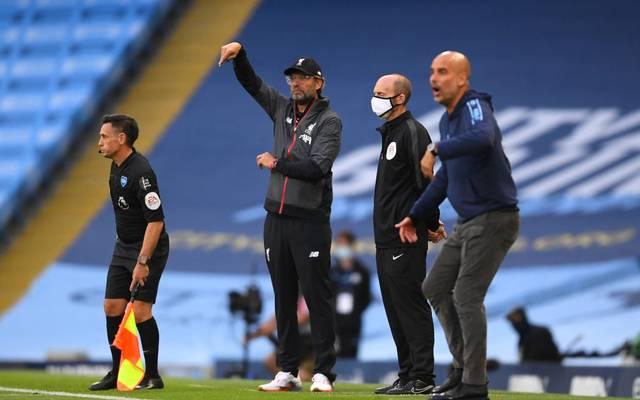 Pep Guardiola (r.) und Jürgen Klopp dominieren mit ihren Teams die Premier League