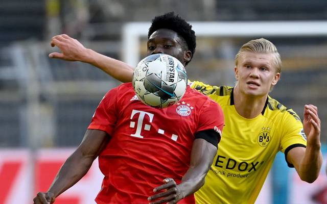 Bayern Munich's Canadian midfielder Alphonso Davies (front) and Dortmund's Norwegian forward Erling Braut Haaland vie for the ball during the German first division Bundesliga football match BVB Borussia Dortmund v FC Bayern Munich on May 26, 2020 in Dortmund, western Germany. (Photo by Federico GAMBARINI / POOL / AFP) / DFL REGULATIONS PROHIBIT ANY USE OF PHOTOGRAPHS AS IMAGE SEQUENCES AND/OR QUASI-VIDEO (Photo by FEDERICO GAMBARINI/POOL/AFP via Getty Images)
