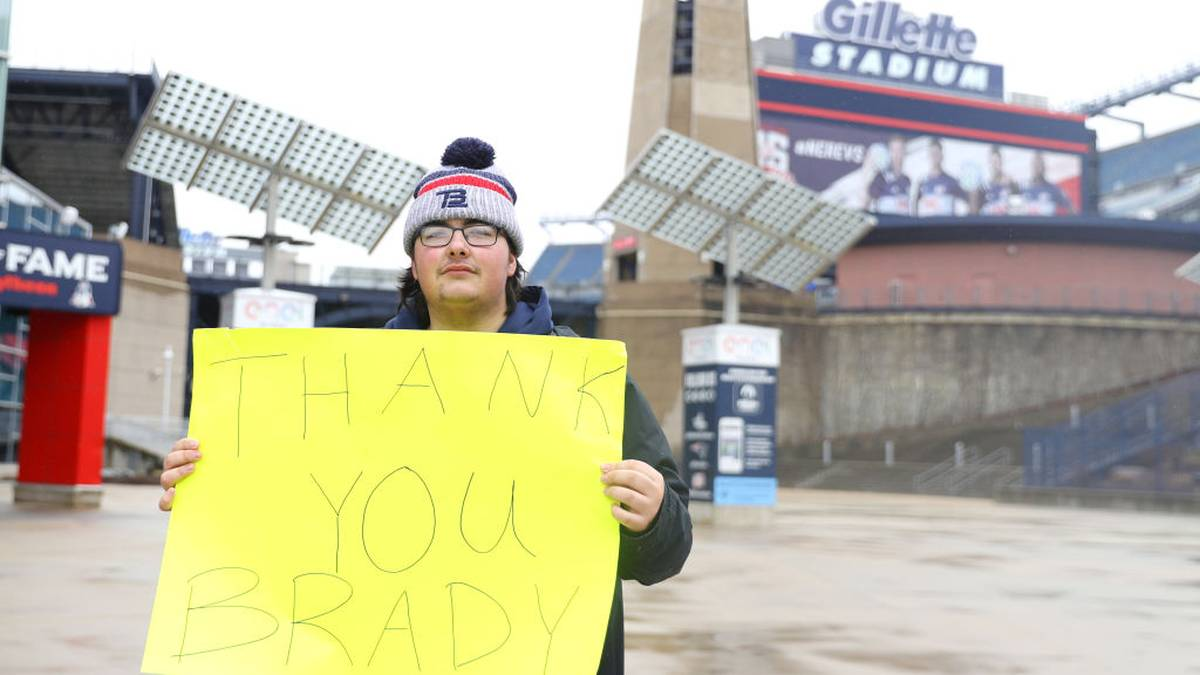 FOXBOROUGH, MASSACHUSETTS - MARCH 17: Patriot fan Kosta Agganis, 19, of Saugus, MA, stands with a sign thanking former New England Patriots quarterback Tom Brady outside of Gillette Stadium on March 17, 2020 in Foxborough, Massachusetts. Brady announced he will leave the Patriots after 20 years with the team to enter free agency. ( (Photo by Maddie Meyer/Getty Images)