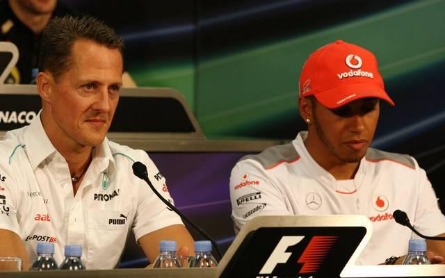 Lewis Hamilton (r.) und Michael Schumacher fuhren zeitweise beide gleichzeitig in der Formel 1