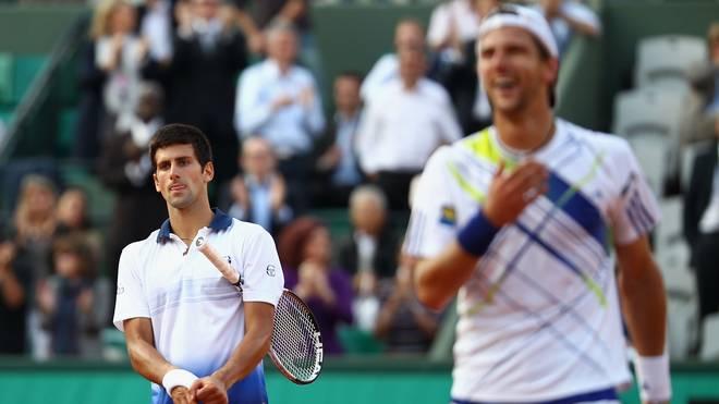 Nach der Niederlage gegen Jürgen Melzer (r.) dachte Novak Djokovic (l.) über einen Rücktritt nach