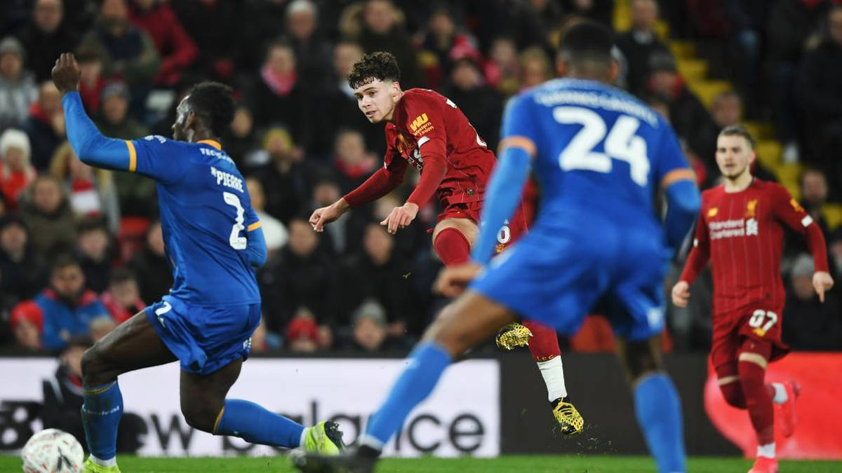 LIVERPOOL, ENGLAND - FEBRUARY 04: Neco Williams of Liverpool shoots as Aaron Pierre of Shrewsbury Town attempts to bock during the FA Cup Fourth Round Replay match between Liverpool FC and Shrewsbury Town at Anfield on February 04, 2020 in Liverpool, England. (Photo by Gareth Copley/Getty Images)
