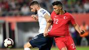 France's Forward Olivier Giroud (L) vies with Turkey's defender Kaan Ayhan during the Euro 2020 football qualification match between Turkey and France at the Buyuksehir Belediyesi stadium in Konya, on June 8, 2019. (Photo by Bulent Kilic / AFP)        (Photo credit should read BULENT KILIC/AFP/Getty Images)