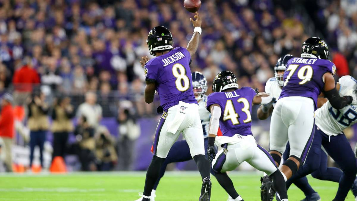 BALTIMORE, MARYLAND - JANUARY 11: Quarterback Lamar Jackson #8 of the Baltimore Ravens throws the ball against the Tennessee Titans in the second half during the AFC Divisional Playoff game at M&T Bank Stadium on January 11, 2020 in Baltimore, Maryland. (Photo by Rob Carr/Getty Images)