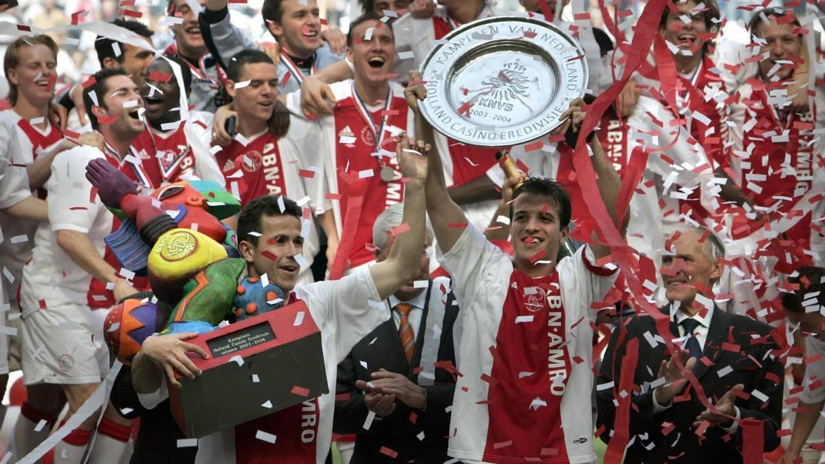 Ajax's captain Rafael van der Vaart hold