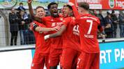 MEPPEN, GERMANY - NOVEMBER 03: Chris Richards of Muenchen celebrate their teams scend with Nicolas Feldhahn, Kwasi Wriedt and Leon Dajaku of Muenchen goal during the 3. Liga match between SV Meppen and Bayern Muenchen II at Haensch-Arena on November 3, 2019 in Meppen, Germany. (Photo by Michael Titgemeyer/Getty Images for DFB)