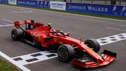 Ferrari's Monegasque driver Charles Leclerc crosses the finish line to win the Belgian Formula One Grand Prix at the Spa-Francorchamps circuit in Spa on September 1, 2019. (Photo by VALDRIN XHEMAJ / POOL / AFP)        (Photo credit should read VALDRIN XHEMAJ/AFP/Getty Images)