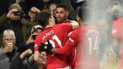 Manchester United's English striker Marcus Rashford (C) celebrates with teammates after scoring their second goal from the penalty spot during the English Premier League football match between Manchester United and Tottenham Hotspur at Old Trafford in Manchester, north west England, on December 4, 2019. (Photo by Oli SCARFF / AFP) / RESTRICTED TO EDITORIAL USE. No use with unauthorized audio, video, data, fixture lists, club/league logos or 'live' services. Online in-match use limited to 120 images. An additional 40 images may be used in extra time. No video emulation. Social media in-match use limited to 120 images. An additional 40 images may be used in extra time. No use in betting publications, games or single club/league/player publications. /  (Photo by OLI SCARFF/AFP via Getty Images)