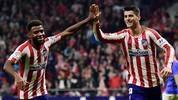 Atletico Madrid's Spanish forward Alvaro Morata (R) celebrates his goal with Atletico Madrid's French midfielder Thomas Lemar during the Spanish league football match between Club Atletico de Madrid and Athletic Club Bilbao at the Wanda Metropolitano stadium in Madrid on October 26, 2019. (Photo by JAVIER SORIANO / AFP) (Photo by JAVIER SORIANO/AFP via Getty Images)