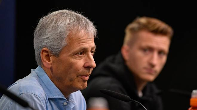Dortmund's Swiss coach Lucien Favre and Dortmund's German forward Marco Reus are pictured during a press conference in Dortmund, western Germany, on September 16, 2019 on the eve of the UEFA Champions League Group F football match between Borussia Dortmund and Barcelona. (Photo by SASCHA SCHUERMANN / AFP)        (Photo credit should read SASCHA SCHUERMANN/AFP via Getty Images)