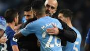 Manchester City's Spanish manager Pep Guardiola (R) embraces Manchester City's Algerian midfielder Riyad Mahrez on the pitch after the English Premier League football match between Manchester City and Chelsea at the Etihad Stadium in Manchester, north west England, on November 23, 2019. - Manchester City won the game 2-1. (Photo by Oli SCARFF / AFP) / RESTRICTED TO EDITORIAL USE. No use with unauthorized audio, video, data, fixture lists, club/league logos or 'live' services. Online in-match use limited to 120 images. An additional 40 images may be used in extra time. No video emulation. Social media in-match use limited to 120 images. An additional 40 images may be used in extra time. No use in betting publications, games or single club/league/player publications. /  (Photo by OLI SCARFF/AFP via Getty Images)
