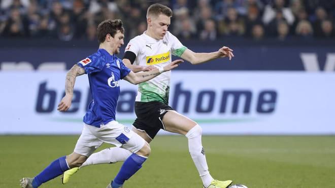 Matthias Ginter (r.) will mit Gladbach gegen Schalke punkten