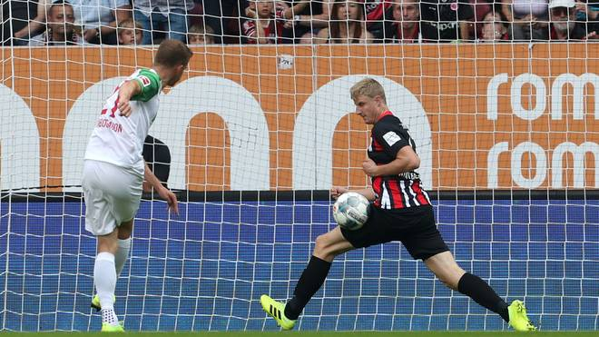 AUGSBURG, GERMANY - SEPTEMBER 14: Alfred Finnbogason (L) of FC Augsburg misses to score against Martin Hinteregger of Eintracht Frankfurt during the Bundesliga match between FC Augsburg and Eintracht Frankfurt at WWK-Arena on September 14, 2019 in Augsburg, Germany. (Photo by Alexandra Beier/Bongarts/Getty Images)