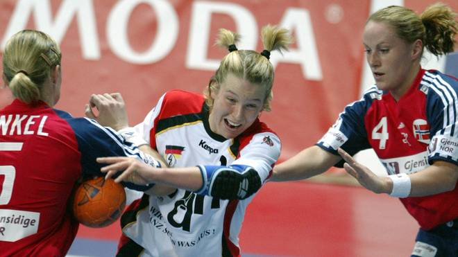 German player Nadine Krause (C) scores a