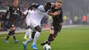 HAMBURG, GERMANY - NOVEMBER 08: Leo Oestigard (R) of FC Sankt Pauli competes for the ball with Silvere Ganvoula (L) of VfL Bochum during the Second Bundesliga match between FC St. Pauli and VfL Bochum 1848 at Millerntor Stadium on November 08, 2019 in Hamburg, Germany. (Photo by Oliver Hardt/Bongarts/Getty Images)
