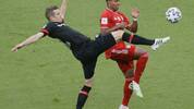 Leverkusen's German defender Sven Bender (L) and Bayern Munich's German midfielder Serge Gnabry vie for the ball during the German Cup (DFB Pokal) final football match Bayer 04 Leverkusen v FC Bayern Munich at the Olympic Stadium in Berlin on July 4, 2020. (Photo by Ronald WITTEK / POOL / AFP) / DFB REGULATIONS PROHIBIT ANY USE OF PHOTOGRAPHS AS IMAGE SEQUENCES AND QUASI-VIDEO. (Photo by RONALD WITTEK/POOL/AFP via Getty Images)