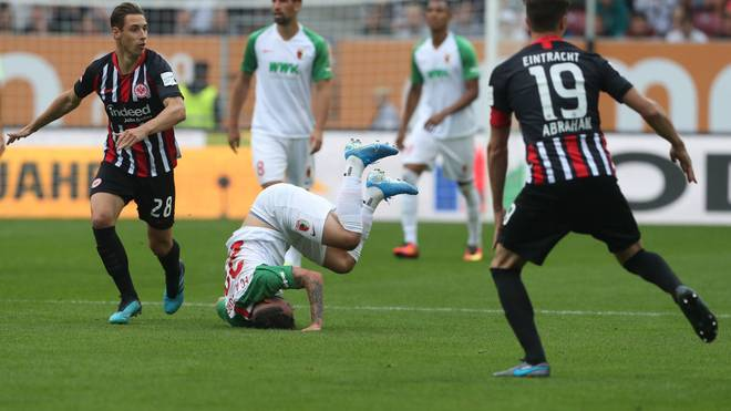 AUGSBURG, GERMANY - SEPTEMBER 14: Philipp Max (C) of FC Augsburg falls during the Bundesliga match between FC Augsburg and Eintracht Frankfurt at WWK-Arena on September 14, 2019 in Augsburg, Germany. (Photo by Alexandra Beier/Bongarts/Getty Images)