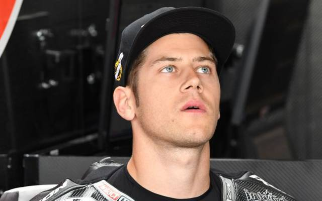 Dynavolt Intact's German rider Marcel Schrotter waits before the third free practice session of the Moto 2 Grand Prix of the Czech Republic in Brno on August 3, 2019. - Dynavolt Intact's Swiss rider Thomas Luthi waits before the third free practice session of the Moto 3 Grand Prix of the Czech Republic in Brno on August 3, 2019. (Photo by Michal CIZEK / AFP)        (Photo credit should read MICHAL CIZEK/AFP/Getty Images)