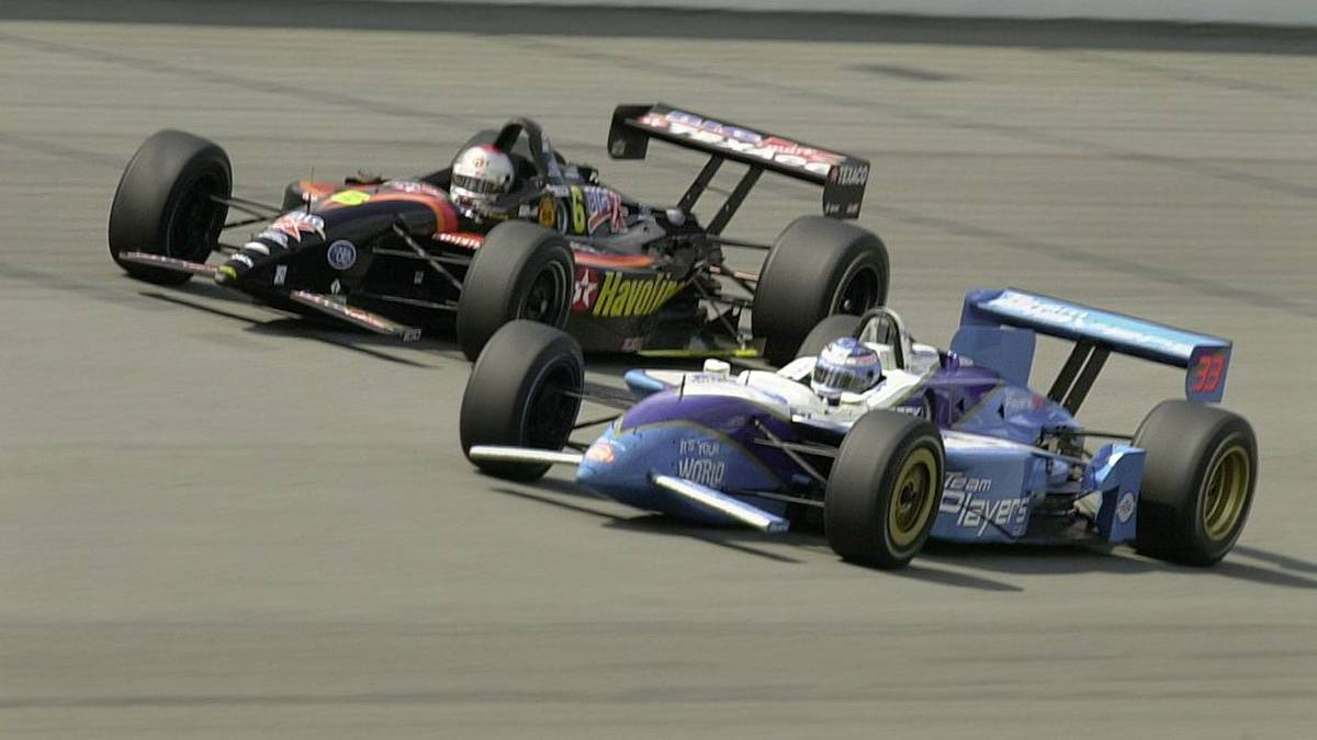 Canadian driver Alex Tagliani (bottom) passes Michael Anedretti of the US (top) to temporarily gain first place in the race on lap 155. Tagliani hit the wall, and left the race five laps later while Andretti finished second during the Michigan 500 on 23, July, 2000 at Michigan Speedway in Brooklyn, MI. (ELECTRONIC IMAGE) AFP PHOTO/David MAXWELL (Photo by DAVID MAXWELL / AFP)        (Photo credit should read DAVID MAXWELL/AFP via Getty Images)