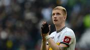 Moenchengladbach's midfielder Marco Reus applauds after the German first division Bundesliga football match Borussia Moenchengladbach vs 1. FC Cologne in the German city of Moenchengladbach on April 15, 2012. Moenchengladbach won the match 3-0. AFP PHOTO / PATRIK STOLLARZ+++ RESTRICTIONS / EMBARGO - DFL LIMITS THE USE OF IMAGES ON THE INTERNET TO 15 PICTURES (NO VIDEO-LIKE SEQUENCES) DURING THE MATCH AND PROHIBITS MOBILE (MMS) USE DURING AND FOR FURTHER TWO HOURS AFTER THE MATCH. FOR MORE INFORMATION CONTACT DFL.        (Photo credit should read PATRIK STOLLARZ/AFP/GettyImages)