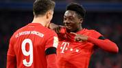 MUNICH, GERMANY - FEBRUARY 21: Robert Lewandowski (L) of Bayern Munich celebrates with Alphonso Boyle Davies of Bayern Munich after scoring his team's third goal during the Bundesliga match between FC Bayern Muenchen and SC Paderborn 07 at Allianz Arena on February 21, 2020 in Munich, Germany. (Photo by Sebastian Widmann/Bongarts/Getty Images)
