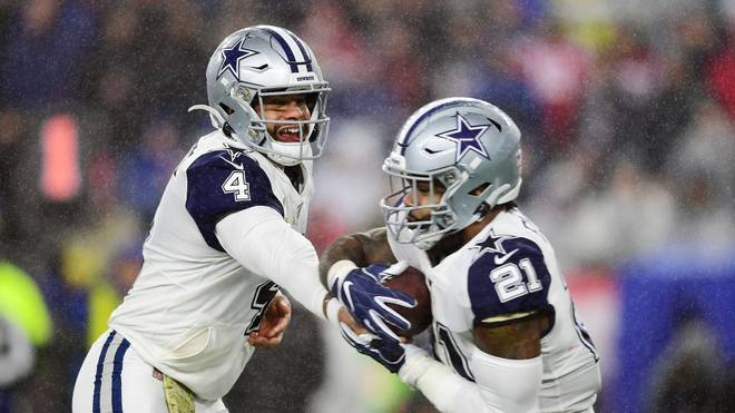 FOXBOROUGH, MASSACHUSETTS - NOVEMBER 24: Dak Prescott #4 of the Dallas Cowboys hands off to Ezekiel Elliott #21 during the first half against the New England Patriots in the game at Gillette Stadium on November 24, 2019 in Foxborough, Massachusetts. (Photo by Billie Weiss/Getty Images)