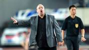 Dalian Yifang's new head coach Rafael Benitez (L) gestures during the Chinese Super League (CSL) football match between Dalian Yifang and Henan Jianye in Dalian in northeast China's Liaoning province on July 7, 2019. (Photo by STR / AFP) / China OUT        (Photo credit should read STR/AFP via Getty Images)