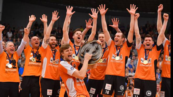 FRIEDRICHSHAFEN, GERMANY - MAY 07: Robert Kromm of Berlin Recycling Volleys celebrates with teammates after winning the Volleyball final playoff match 3 between VFB Friedrichshafen and Berlin Recycling Volleys at ZF Arena on May 7, 2017 in Friedrichshafen, Germany. (Photo by Sebastian Widmann/Bongarts/Getty Images)