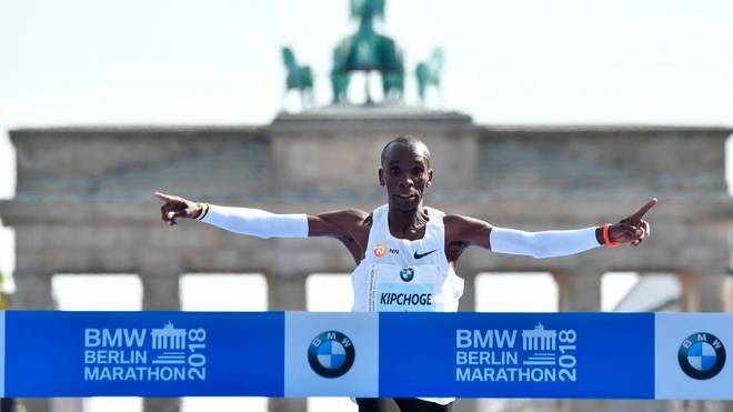 TOPSHOT - Kenya's Eliud Kipchoge crosses the finish line to win the Berlin Marathon setting a new world record on September 16, 2018 in Berlin. (Photo by John MACDOUGALL / AFP)        (Photo credit should read JOHN MACDOUGALL/AFP/Getty Images)