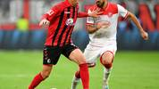 DUESSELDORF, GERMANY - SEPTEMBER 29: Janik Haberer of Sport-Club Freiburg (L) holds off Kenan Karaman of Fortuna Dusseldorf  during the Bundesliga match between Fortuna Duesseldorf and Sport-Club Freiburg at Merkur Spiel-Arena on September 29, 2019 in Duesseldorf, Germany. (Photo by Lukas Schulze/Bongarts/Getty Images)