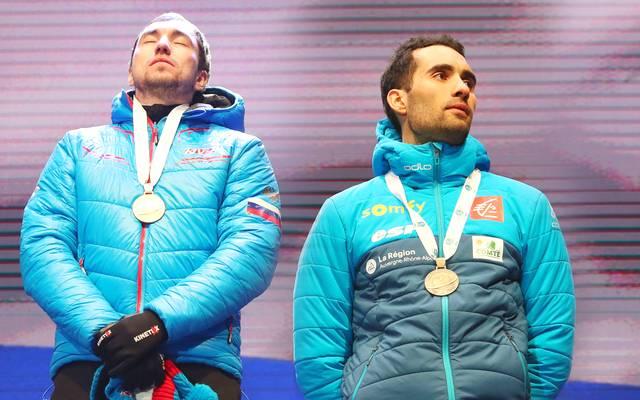 Alexander Loginov (l.) steht bei der Biathlon-WM in der Kritik