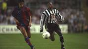 17 Sep 1997:  Michael Reiziger (left) of Barcelona takes on Faustino Asprilla (right) of Newcastle United during the Champions League match at St James'' Park in Newcastle-upon-Tyne, England. Newcastle United won the match 3-2.   \ Mandatory Credit: CliveBrunskill/Allsport