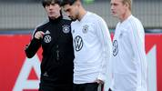 DORTMUND, GERMANY - OCTOBER 07: (L-R) Head coach Joachim Loew talks to Suat Serdar of Germany during a training session at BVB-Trainingsgelaende on October 07, 2019 in Dortmund, Germany. Germany will play against Argentina in an international friendly match on October 9, 2019 in Dortmund. (Photo by Christof Koepsel/Bongarts/Getty Images)