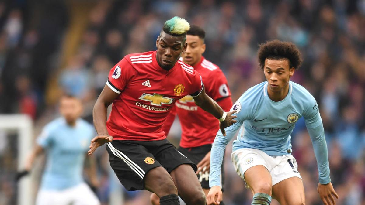 MANCHESTER, ENGLAND - APRIL 07:  Paul Pogba of Manchester United is challenged by Leroy Sane of Manchester City during the Premier League match between Manchester City and Manchester United at Etihad Stadium on April 7, 2018 in Manchester, England.  (Photo by Michael Regan/Getty Images)