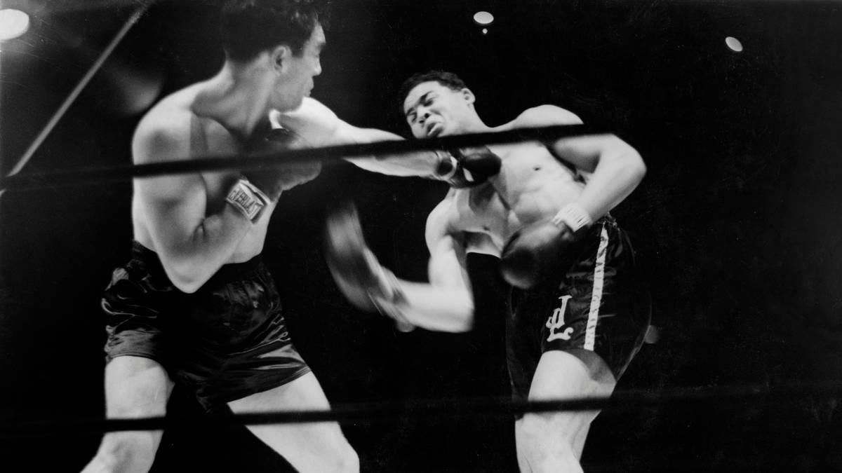 Max Schmeling (l.) setzte sich am 19. Juni 1936 überraschend gegen Joe Louis durch