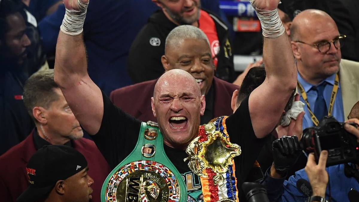 British boxer Tyson Fury celebrates after defeating US boxer Deontay Wilder in the seventh round during their World Boxing Council (WBC) Heavyweight Championship Title boxing match at the MGM Grand Garden Arena in Las Vegas on February 22, 2020. (Photo by Mark RALSTON / AFP) (Photo by MARK RALSTON/AFP via Getty Images)