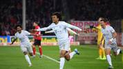 FREIBURG IM BREISGAU, GERMANY - DECEMBER 18:  Joshua Zirkzee of Bayern Munich celebrates with team-mates after scoring his team's second goal during the Bundesliga match between Sport-Club Freiburg and FC Bayern Muenchen at Schwarzwald-Stadion on December 18, 2019 in Freiburg im Breisgau, Germany. (Photo by Matthias Hangst/Bongarts/Getty Images)