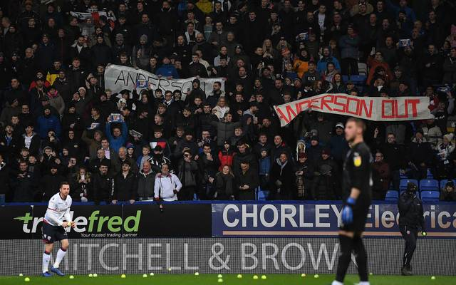 BOLTON, ENGLAND - JANUARY 21:  Andrew Taylor of Bolton removes tennis balls thrown onto the pitch by the home supporters in protest to chairman Ken Anderson prior to kick off during the Sky Bet Championship match between Bolton Wanderers and West Bromwich Albion at University of Bolton Stadium on January 21, 2019 in Bolton, England. (Photo by Gareth Copley/Getty Images)