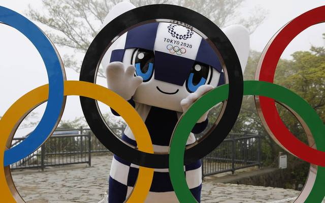 April 14, 2021, Hachioji, Japan: Tokyo 2020 Olympic Games mascot MIRAITOWA poses with a display of Olympic Symbol after unveiling ceremony of the symbol on Mt. Takao in Hachioji, west of Tokyo, to mark 100 days before the start of 2020 Tokyo Olympic Games. Hachioji Japan - ZUMAz114 20210414_zih_z114_005 Copyright: xPOOLx