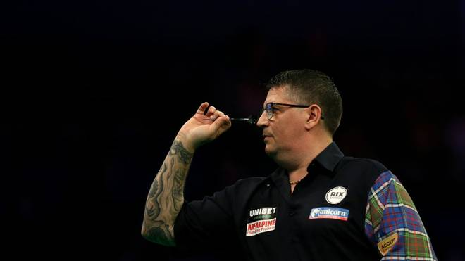 LIVERPOOL, ENGLAND - MARCH 12: Gary Anderson throws a dart in his match against Nathan Aspinall during Night Six of the Premier League Darts at the M&S Bank Arena on March 12, 2020 in Liverpool, England. (Photo by Lewis Storey/Getty Images)