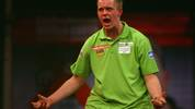 LONDON - DECEMBER 18:  Michael van Gerwen of Netherlands celebrates winning a leg during the first round match between Phil Taylor of England and Michael van Gerwen of Netherlands during the 2008 Ladbrokes.com PDC World Darts Championship at Alexandra Palace on December 18, 2007 in London, England.  (Photo by Paul Gilham/Getty Images)
