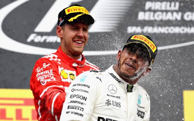 Sebastian Vettel (l.) und Lewis Hamilton