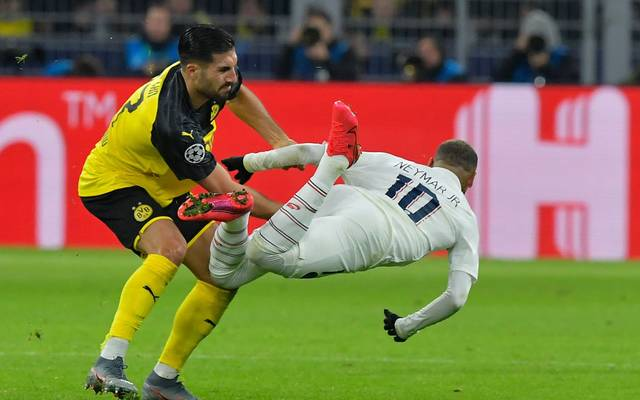 Paris Saint-Germain's Brazilian forward Neymar (R) goes down after a challange by Dortmund's German midfielder Emre Can during the UEFA Champions League Last 16, first-leg football match BVB Borussia Dortmund v Paris Saint-Germain (PSG) in Dortmund, western Germany, on February 18, 2020. (Photo by Tobias SCHWARZ / AFP) / The erroneous mention[s] appearing in the metadata of this photo by Tobias SCHWARZ has been modified in AFP systems in the following manner: [Dortmund's German midfielder Emre Can] instead of [Dortmund's Moroccan defender Achraf Hakimi]. Please immediately remove the erroneous mention[s] from all your online services and delete it (them) from your servers. If you have been authorized by AFP to distribute it (them) to third parties, please ensure that the same actions are carried out by them. Failure to promptly comply with these instructions will entail liability on your part for any continued or post notification usage. Therefore we thank you very much for all your attention and prompt action. We are sorry for the inconvenience this notification may cause and remain at your disposal for any further information you may require. (Photo by TOBIAS SCHWARZ/AFP via Getty Images)